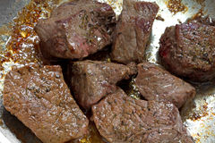 Cooked beef sirloin tips in frying pan Royalty Free Stock Photography