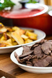Cooked beef slices on plate Stock Photos
