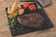 Cooked beef steak sliced medium rare close-up. A royalty free stock photos