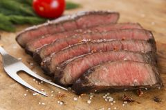 Cooked beef steak sliced medium rare close-up. A stock image