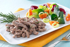 Cooked beef with vegetables and rosemary Royalty Free Stock Photography