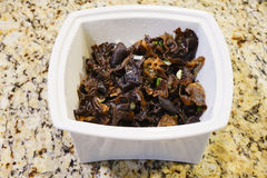 Cooked black Edible Tree Fungus in a white bowl Royalty Free Stock Photography