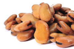 Cooked bread beans. A pile of cooked bread beans on a white background stock photos