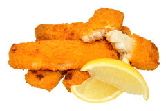 Cooked Breadcrumb Coated Fish Fingers. With lemon wedges isolated on a white background Stock Images