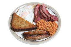 Cooked Breakfast. Full English fried breakfast with sausage, bacon, egg, beans and fried bread Royalty Free Stock Image