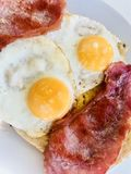 Cooked breakfast with bacon and eggs Royalty Free Stock Photography