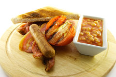 Cooked Breakfast Items on a Wooden Plate Royalty Free Stock Photos