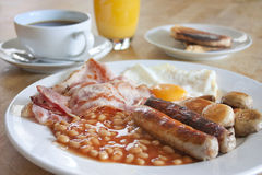Cooked breakfast on a wooden table royalty free stock photos