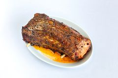 Cooked brisket sprinkled with spices and herbs. royalty free stock photo