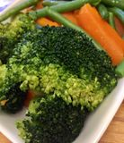 Cooked broccoli with fresh carrots and beans Stock Image