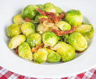 Cooked Brussel Sprouts with Sundried Tomatoes and Shallot Royalty Free Stock Images