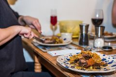 Cooked buckweat portions on colorful plate over female hands at dinner table.  stock photos