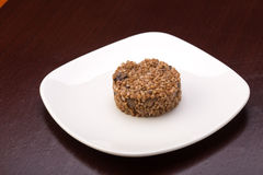 Cooked buckwheat. With mushrooms on the plate on wooden table Royalty Free Stock Images
