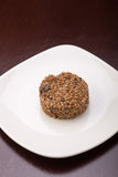 Cooked buckwheat. With mushrooms on the plate on wooden table Stock Images