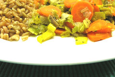 Cooked bulgur wheat groats, carrots and leek Royalty Free Stock Photography