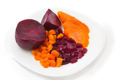 Cooked carrot and beet on plate Royalty Free Stock Photo