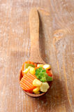 Cooked carrots sweet corn and broccoli in a wooden Stock Image