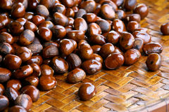 Cooked chestnuts on basket in Philippine market Stock Photography