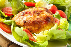 Baked chicken breast with salad Royalty Free Stock Photo