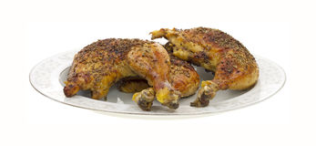Cooked chicken on dish Stock Images