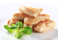 Cooked chicken fillets Royalty Free Stock Images