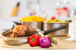 Cooked chicken with rice in white kitchen Stock Photography