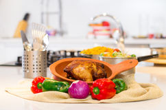 Cooked chicken with rice in white kitchen Stock Photo
