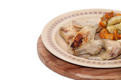 Cooked chicken wings with vegetables. On the plate Royalty Free Stock Photography