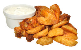 Cooked Chicken Wings And Wedges Royalty Free Stock Photo