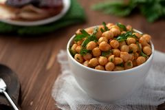 Cooked chickpeas with parsley royalty free stock image