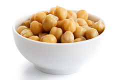 Cooked chickpeas in white bowl. Royalty Free Stock Image