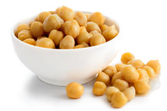 Cooked chickpeas in white bowl on white. Royalty Free Stock Image