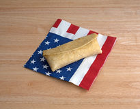 Cooked chimichanga on flag napkin Stock Photo