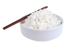 Cooked china rice and porcelain bowl. White cooked china rice inside porcelain bowl stock photo