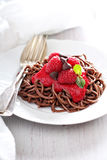 Cooked chocolate pasta with raspberry sauce Royalty Free Stock Photography
