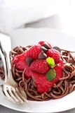 Cooked chocolate pasta with raspberry sauce Royalty Free Stock Image