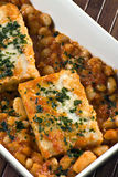 Cooked cod with beans and sauce Stock Image