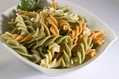 Cooked colored pasta. Bowl full of cooked colored pasta - fusilli Stock Photography