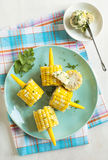 Cooked corn with herb butter Stock Photo