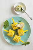 Cooked corn with herb butter Stock Photos