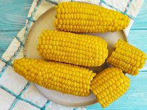 Cooked corn, a plate autumn healthy delicious fresh natural agriculture ingredient food appetizer on a blue wooden background,. Cooked corn a plate on a blue royalty free stock photography