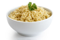 Cooked couscous with green parsley in white ceramic bowl isolate Stock Images