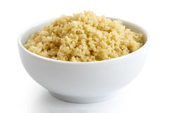 Cooked couscous in white ceramic bowl. Stock Photography