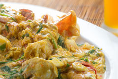 Cooked curry crabs with spicy sauce on white plate Stock Photography