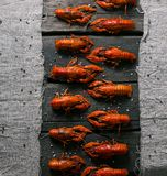 Cooked delicious red crayfish on wooden table top royalty free stock image