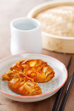 Cooked dim sums with soy sauce. Cooked dim sums chinese dumplings with soy sauce Stock Photo