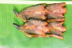 Cooked dried fish for retail sale in local market Stock Photos