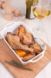Cooked duck legs with thyme and sweet potato Stock Photos