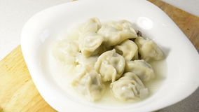 Cooked dumplings dish stock footage