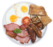 Cooked English Breakfast. Full English cooked breakfast with bacon, sausages and fried eggs Royalty Free Stock Image
